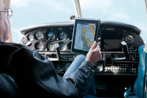 A pilot checks his tablet with ease, thanks to NuShield's DayVue antireflective film.